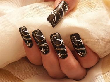 Малюнки на нігтях голкою
